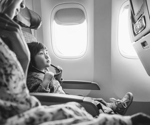 Child on airplane with mother