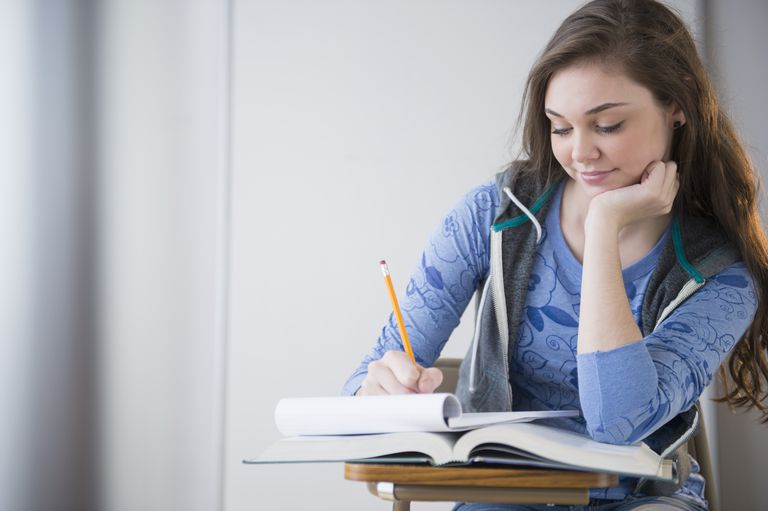 Hispanic girl studying at desk
