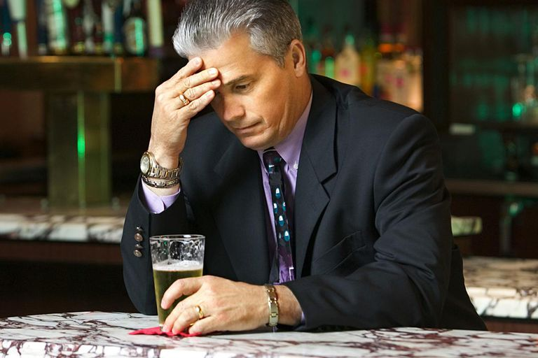 Downcast businessman in bar