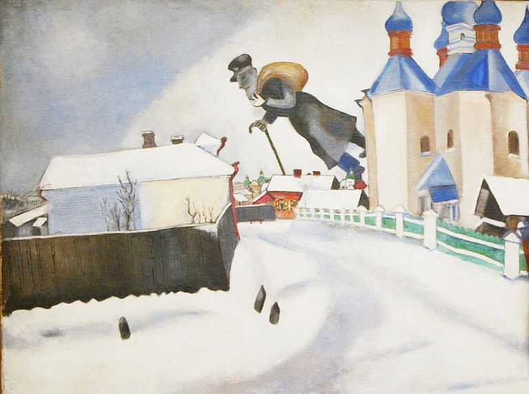 An enormous man with a black coat, a bag, and a cane floats over a snow-covered village with onion-dome churches