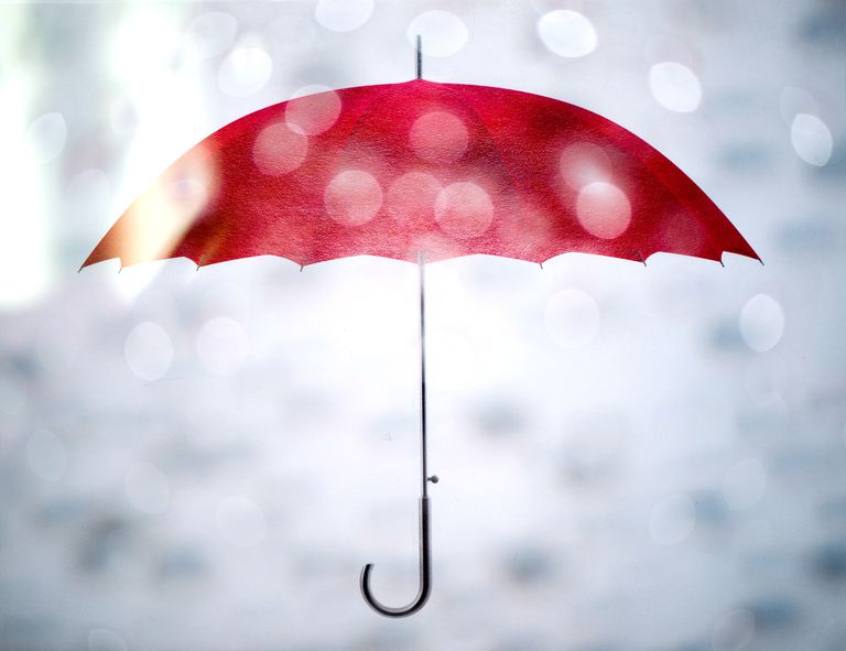 Red umbrella through raindrops
