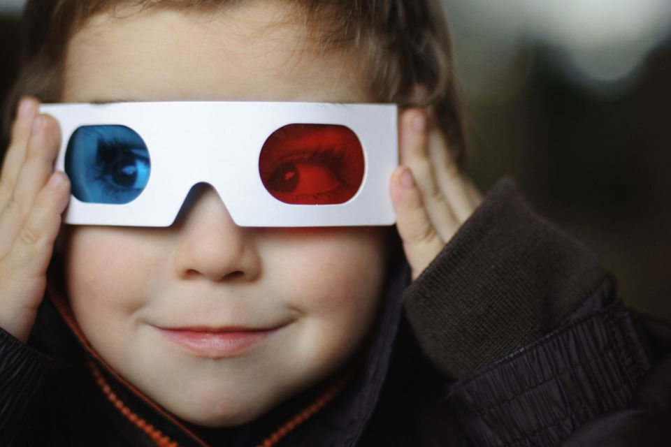 Little boy looks through 3D glasses