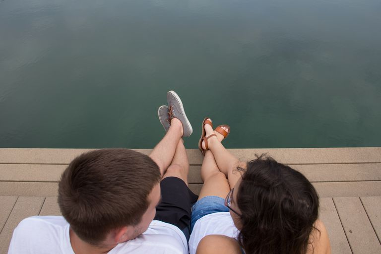 Young Couple sitting by waterfront
