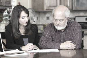 Man reviewing paperwork with attorney