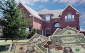 cash and coins in front of a brick house
