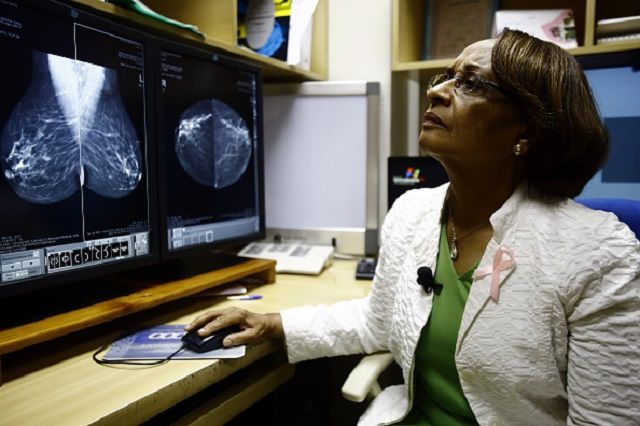 radiologist looking at a mammogram