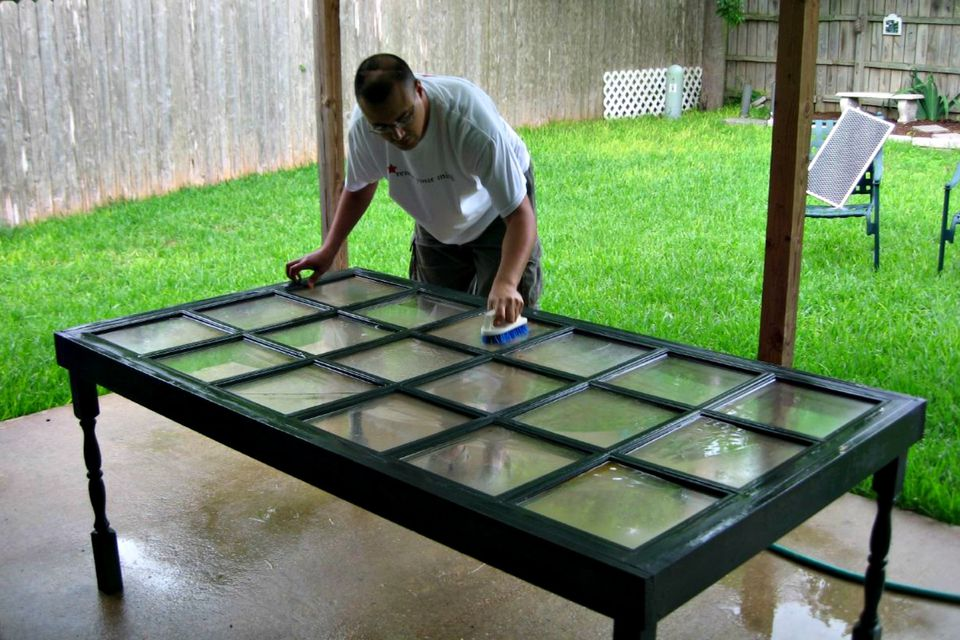 man making table out of discarded old window