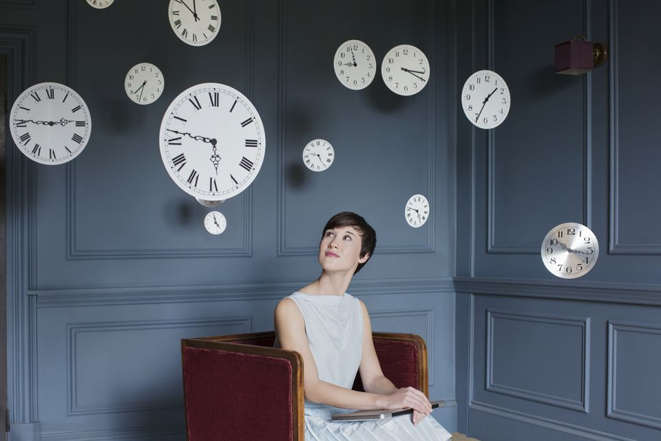 Woman in Armchair with Clocks