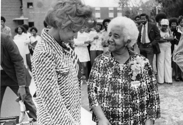 American inventor Marjorie Stewart Joyner (1896 - 1994) (right) speaks with an unidentified woman at an unidentified, outdoor event, late 1960s