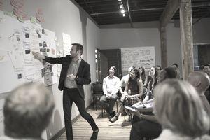 Audience watching speaker lead presentation