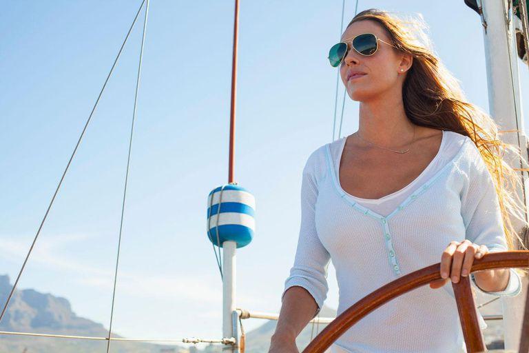 Woman steering yacht