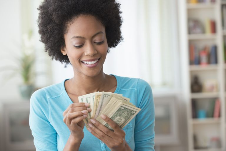 Woman counting child support money