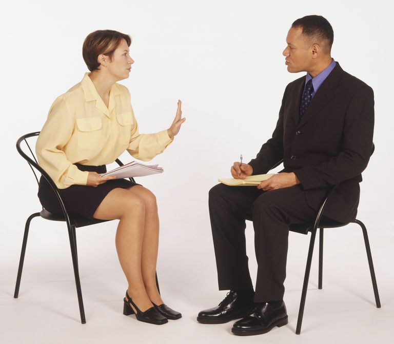 man and woman having tense conversation