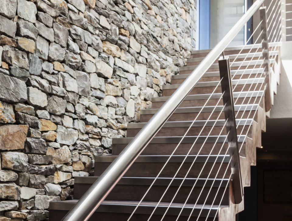 Stone Wall Next To Modern Staircase