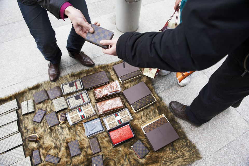 Fake Louis Vuitton Wallets being sold on the street. March 29, 2010