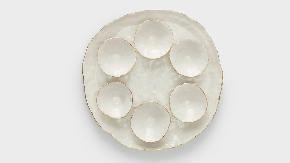 Isabel Halley makes beautiful handmade pieces using porcelain, clear glaze and a 22 karat gold.