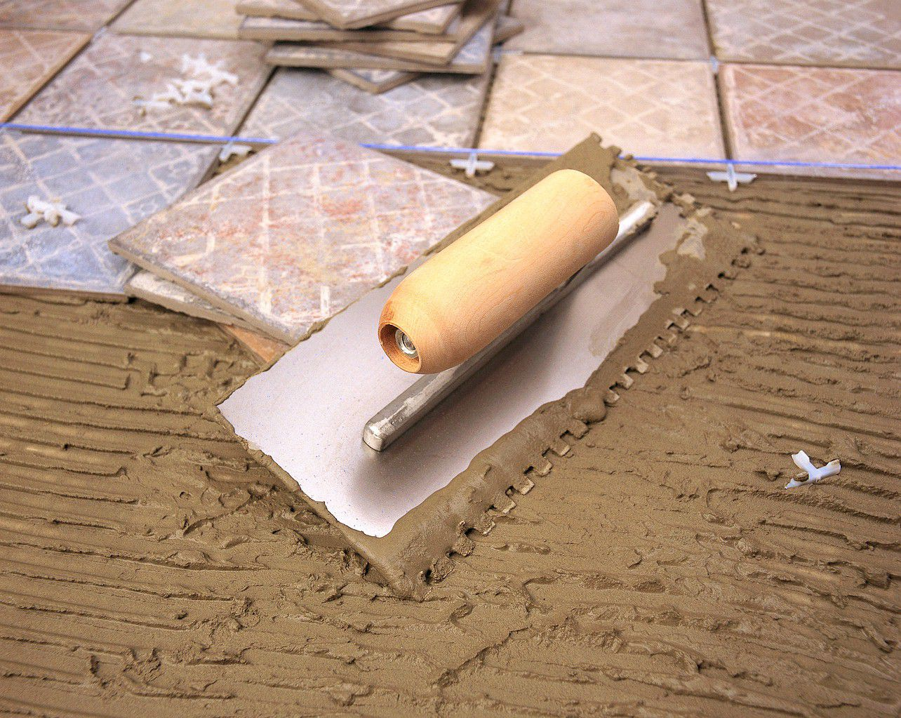 Learn how to install wall tiles how to prep mix mortar layout grout and install floor tiles dailygadgetfo Image collections
