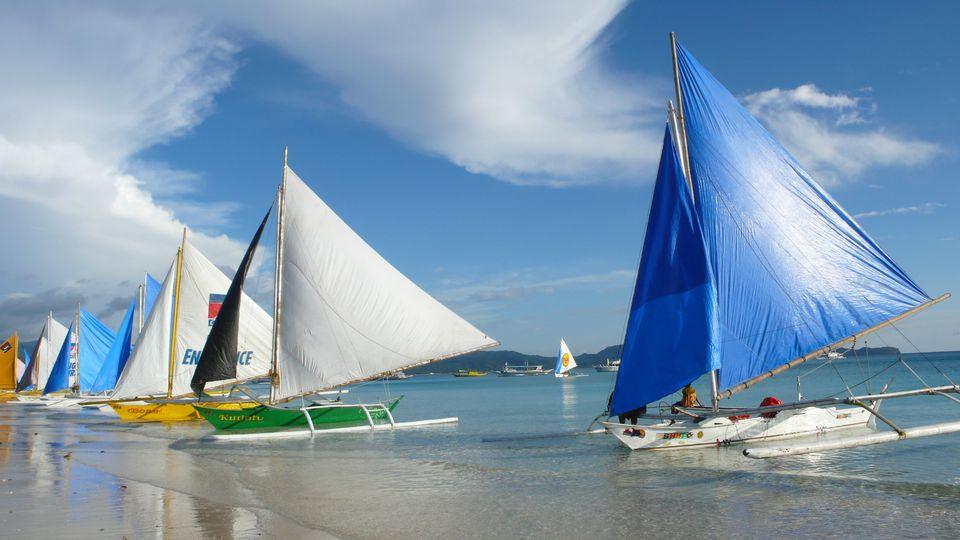Paraw lining White Beach, Boracay Island, Philippines.