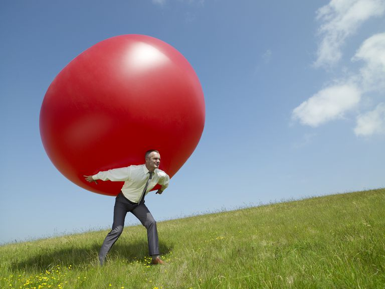 The work required to carry a ball up a hill is the energy needed to act against the force of gravity.