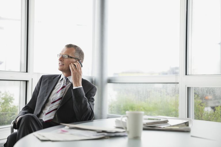 Businessman talking on phone in boardroom