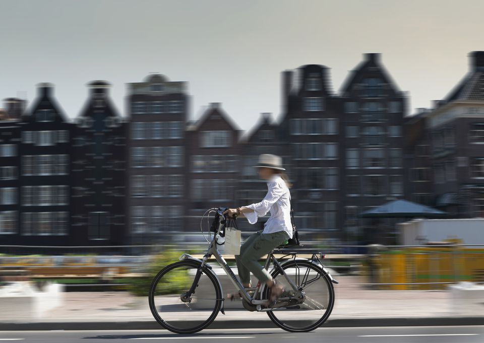 Blurred view of bicyclist on Amsterdam street, Netherlands