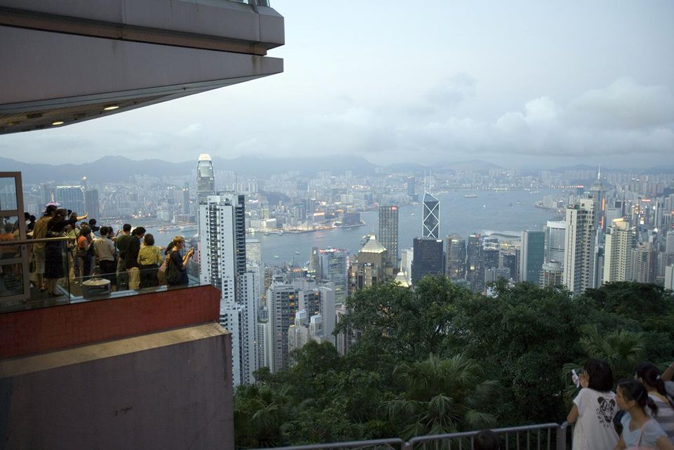 People at Victoria Peak looking over Central's office towers
