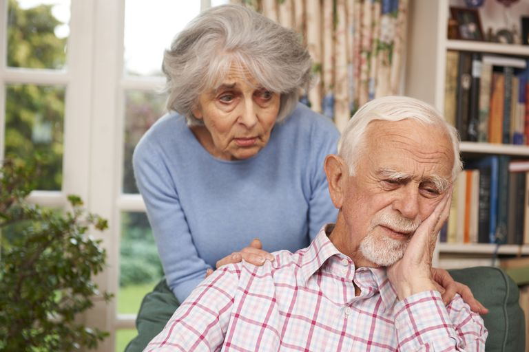 Woman comforts sad looking man