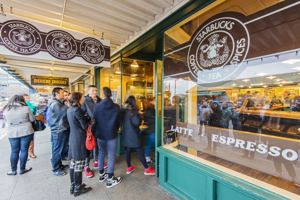 Tourists queuing to get inside Starbucks first coffee place opened in 1971, Seattle, Washington, USA