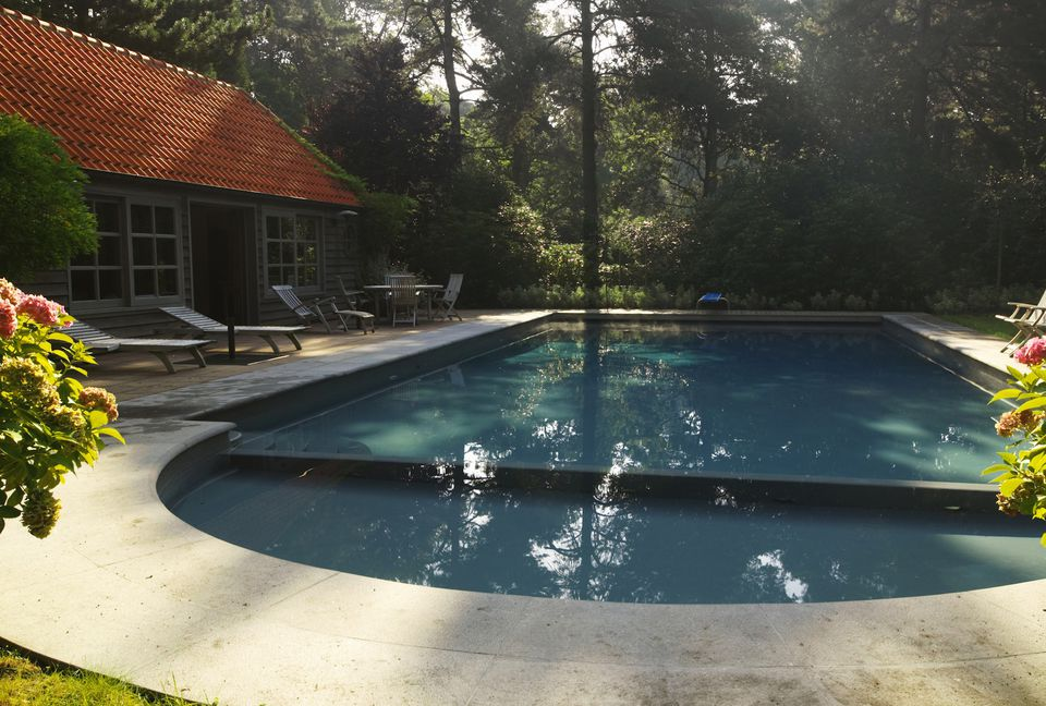 timber clad summer house next to swimming pool belgium - Outdoor House Pools