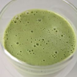 An image of a Matcha Green Tea Smooothie made with banana and coconut milk.