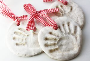 Handprint ornaments with a ribbon.