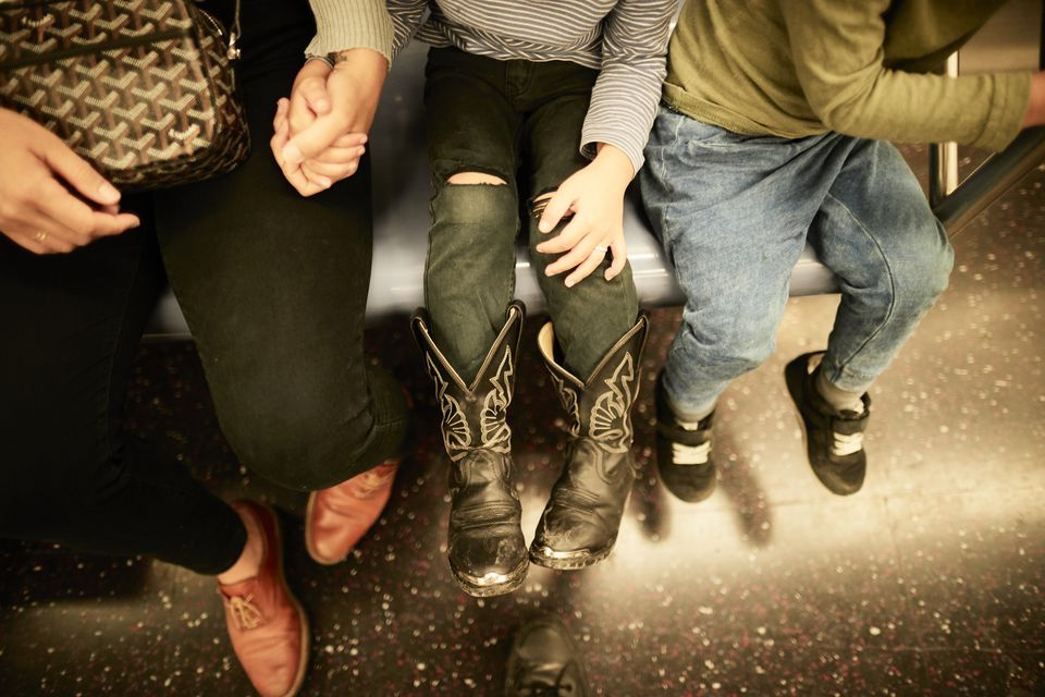Mother And Sons On Subway Train