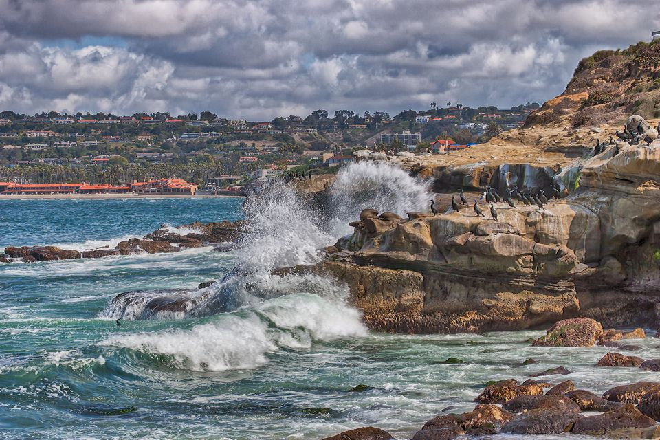 Waves crashing against rocks on La Jolla, California