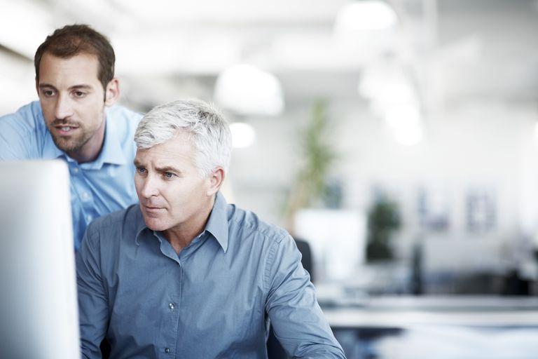 two men at computer