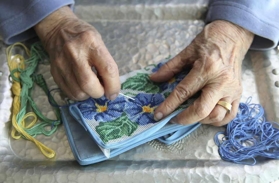 woman stitching needlepoint-Getty Images