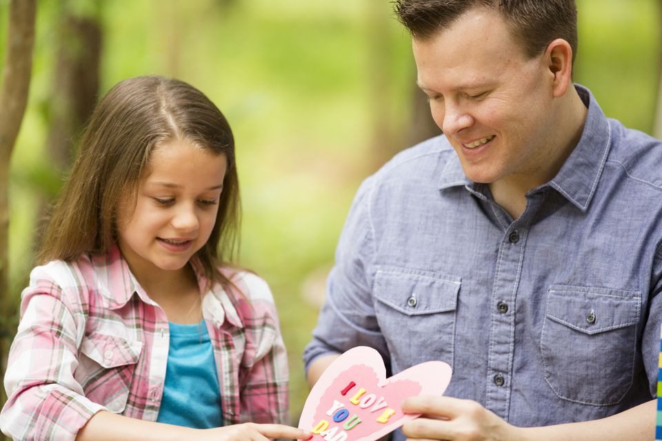 Father and daughter working on a Valentine craft