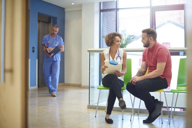 Man and doctor talking in doctor's office