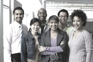 Multi-ethnic business people of integrity are posing in the office.