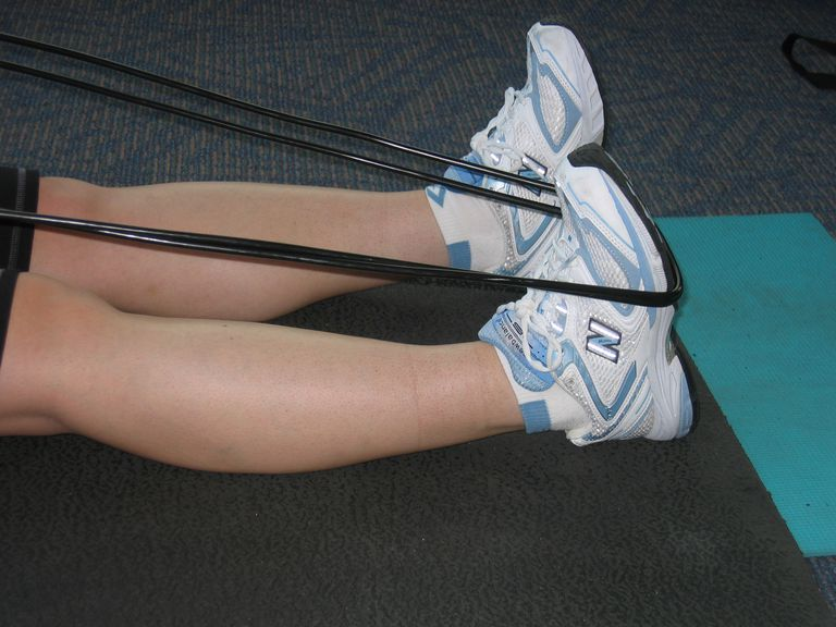 Seated ankle dorsiflexion and calf stretch using a rope.