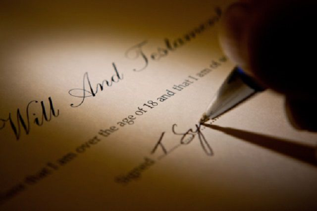 Signing A Last Will And Testament Document