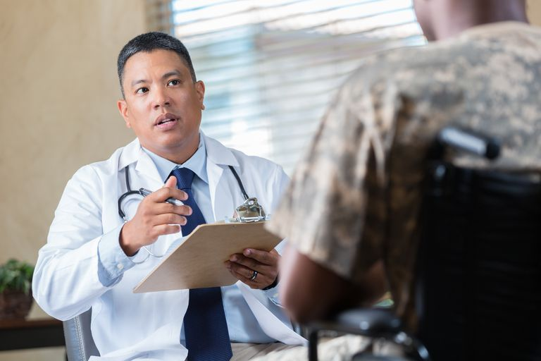 Medical doctor evaluates veteran during appointment