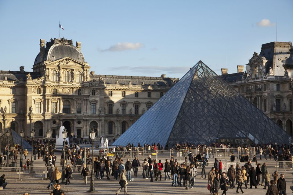 Crowds of people outside the Louvre in Paris