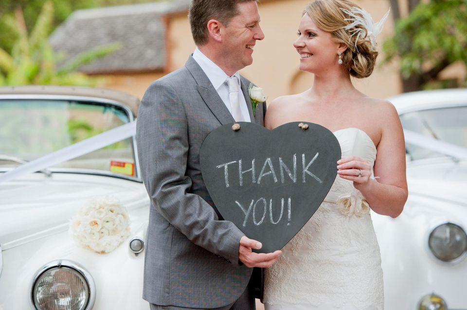 Wedding thank you note wording bride groom with thank you sign junglespirit Image collections