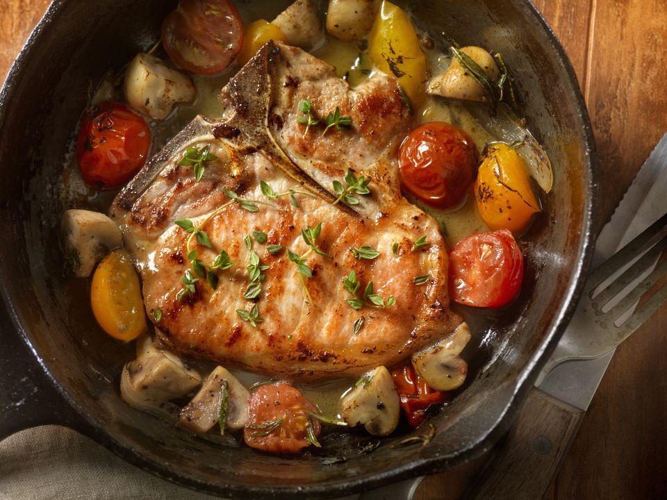 Pork chop and vegetables in skillet