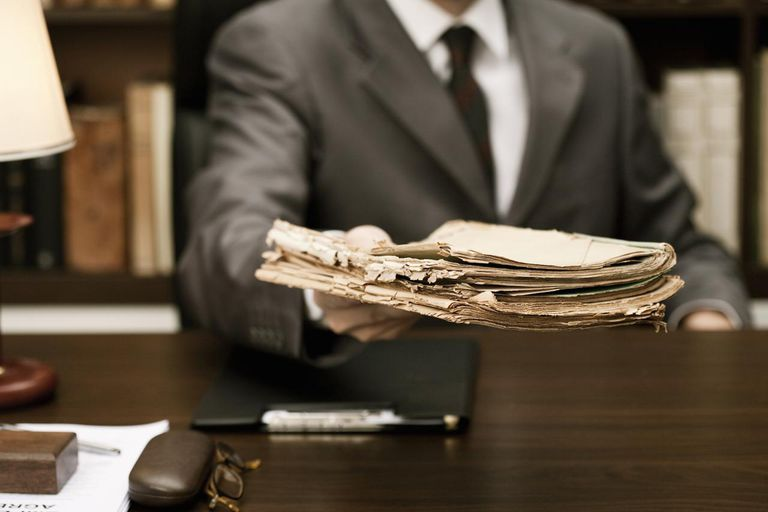 Businessman offering old documents