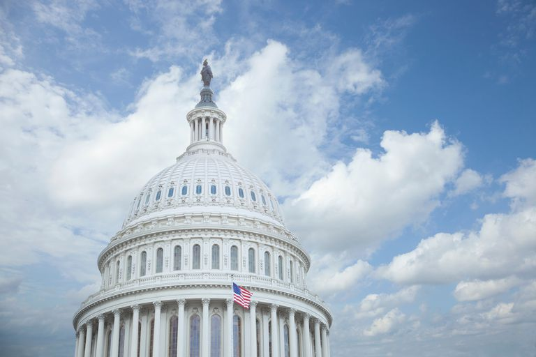 Low Angle View Of United States Capitol Against Cloudy Sky In City