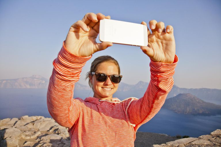 A young women taking a picture of herself outside