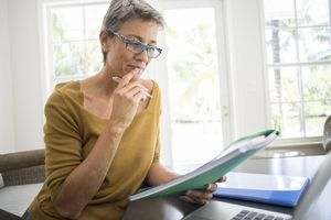 Woman looking at her retirement income plan.