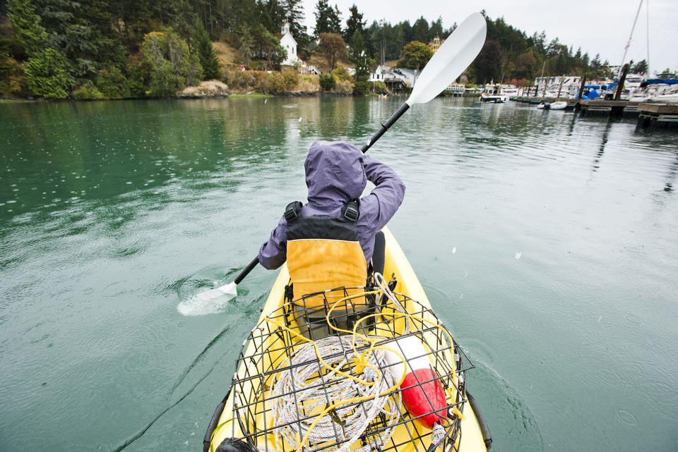 A girl kayaks through Roche Harbor, Washington.