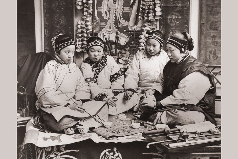 Chinese women playing a game together, about 1900 (unknown location)